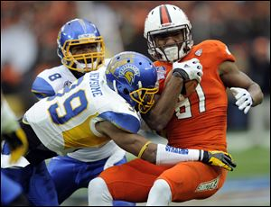 San Jose State safety Cullen Newsome tackles Bowling Green wide receiver Chris Gallon in the first half of Thursday's Military Bowl in Washington. Gallon finished with seven catches for the Falcons, who finish with an 8-5 record.