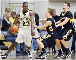 From left, Whitmer's Nigel Hayes gets by Northview's  Mark Bernsdorff and Connor Hartnett. Hayes had 14 points and 20 rebounds.