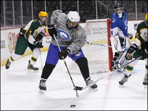Anthony Wayne High School player Carson Bales, 72, steals the puck from Oregon Clay High School player Andrew Pappas, 25, right, during the first period.