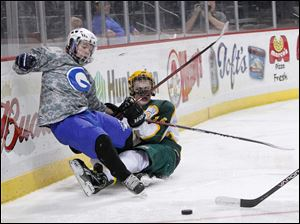 Anthony Wayne High School player Chad Bialecki, 22, is dragged down by Oregon Clay High School player Andrew Sterling, 14, during the second period at the Huntington Center.