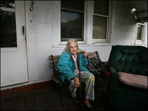 Flora Shirey of Moore Street in Toledo, Ohio, had her television stolen when 2 masked men broke into her house around 4:30 a.m. Tuesday, June 5, 2012.