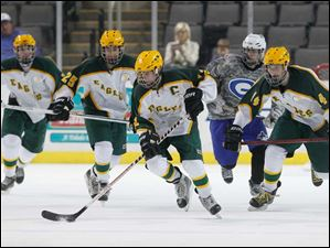 Oregon Clay High School player James LaPlante, 12, leads the charge against Anthony Wayne High School during the first period at the Huntington Center.