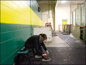 Madison Carter, of Bedford, laces up her skates before hitting the ice.
