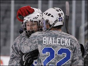 Anthony Wayne High School players Mike McDougall, 17, and Chad Bialecki, 22, celebrate McDougll's goal against Oregon Clay High School during the second period.