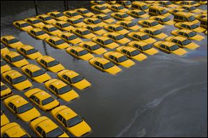 A parking lot full of yellow cabs is flooded as a result of Superstorm Sandy in Hoboken, N.J.
