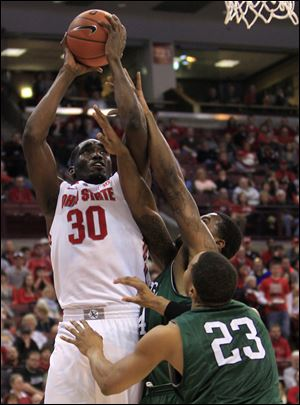 Ohio State's Evan Ravenel, left, is fouled by Chicago State's Markus Starks,