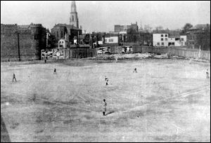 St. Mary's Roman Catholic Church stood in the background of the Armory Park baseball field, where the Notre Dame-University of Michigan game was played 110 years ago.