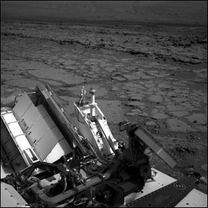 The Mars rover Curiosity at a pit stop, a shallow depression called