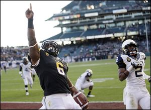Arizona State running back Cameron Marshall celebrates his 33-yard touchdown run near Navy cornerback Parrish Gaines.