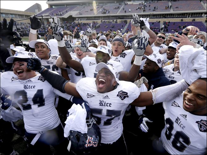 Rice linebacker Cameron Nwosu (57) celebrates with safety Paul Porras (24) and defensive end Dylan Klare (96) after their Armed Forces Bowl winagainst Air Force.