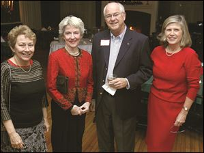 From left, Josie Kramer, Caryln Obendorfer, and Dan and Nancy Lehmann at the Junior League of Toledo holiday party at Carranor Hunt & Polo Club in Perrysburg.