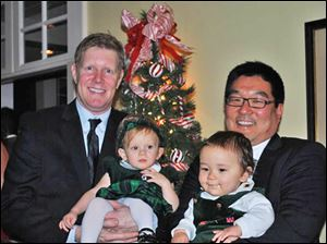 Jim Nooney, Jr., holds daughter Lillian, and Phillip Lee with son Peter at the Carranor Hunt & Polo Club Family Christmas dinner.