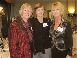 Nancy Ligibel, Carol Arnold, and Linda McBee made sure the silent auction ran smoothly for the Toledo Animal Shelter's Christmas party at the Inverness Club.