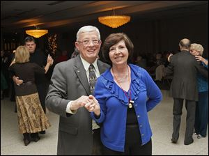 Bob and Susan Darmofal enjoy the sounds of the Swingmania Orchestra during the Jingle Bell Ball.