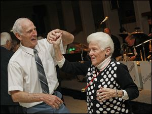 Ron Martin, left, dances with Fran Rideout during this year's Paramount's Jingle Bell Ball.