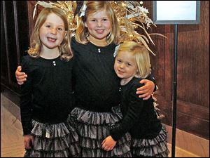 Lucy Hylant, 7, left waits to visit with Santa with her cousins Lily, 5, center and Skylar Berenzwieg, 3, at the Christmas Tea Dance.