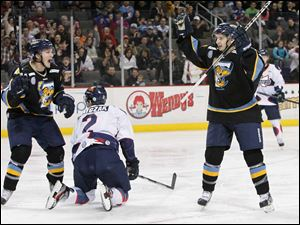 Toledo's Adam Hobson (10) and Terry Broadhurst (27) celebrate Broadhurst's first-period goal against the Wings.