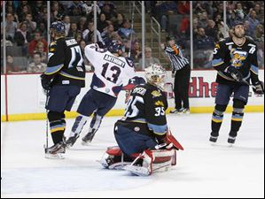 Toledo goalie Kent Simpson (35) gives up a goal to the Kalamazoo Wings during the second period.