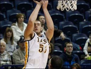 UT's Nathan Boothe shoots over Illinois-Chicago's Josh Crittle during game at Savage Arena.