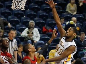 Toledo's Matt Smtih shoots over UIC defenders.