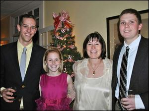 Sam Rothman, Kate Sabin, Mary Sabin and Grant MacPherson enjoy the Christmas gathering at Carranor Hunt & Polo Club in Perrysburg.