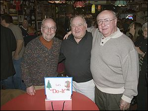 From left, Jeff James, Bob Wasserman, and Ron Buermele at the 46th annual Do-It Party at the Players Club.