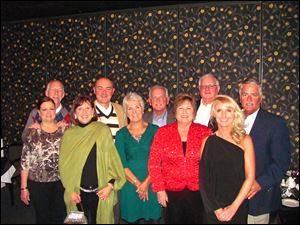 The Gourmet Group gathered to celebrate the holiday season at Georgio's Cafe International. Pictured are, front row from left, Kathy Cromwell, Kim Axe, Nancy Nopper, Sally Crowell, and Teri Trimmer. In the back row, from left, are Dick Cromwell, Bill Axe, Bill Nopper, Dick Crowell, and Rick Kaifas.