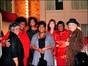 From left are, Mary Austin, Susan Taylor, Gwen Johnson, Arma Austin-Frazier, Judy Barwick-Jans, Susan's mother in red Roberta Taylor, and Martha Sloan.