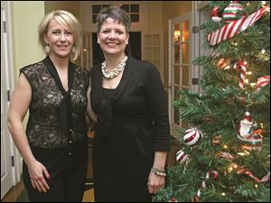 Board member Kristina Tracey and president Anne Ruggiero at the Junior League of Toledo holiday party.