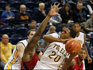 Toledo's Julius Brown is defended by UIC's Josh Crittle.