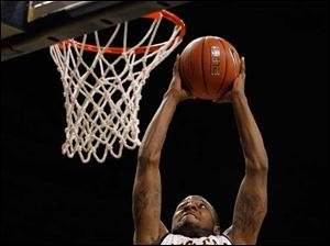 Toledo's Rian Pearson reaches to dunk the ball during game against the Illinois-Chicago Flames.