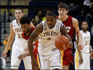 Toledo's Rian Pearson sprints down court with a stolen ball from the Flames.