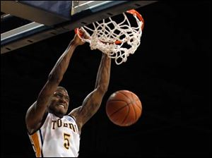 Toledo Rockets player Rian Pearson dunks the ball.