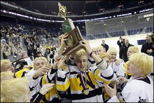 Dalton Carter holds up the state hockey championship trophy after Northview defeated Lakewood St. Edward 5-2 in the final at Nationwide Arena in Columbus.