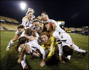 Perrysburg celebrates defeating Mason 1-0 at Crew Stadium in Columbus to capture the Division I girls soccer state championship and complete a 23-0-0 season.