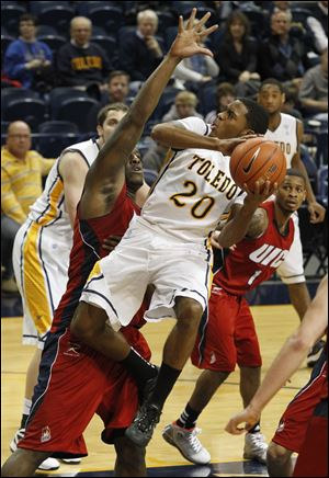 Toledo's Julius Brown is defended by Illinois-Chicago's Josh Crittle as he looks to take a shot Saturday.