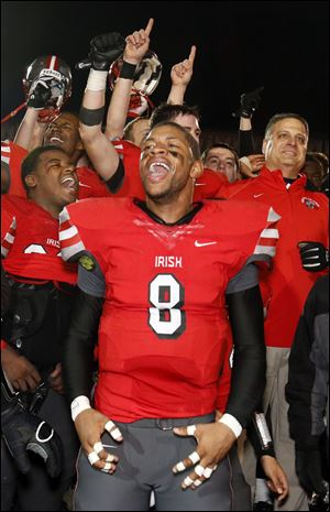 Jayme Thompson leads the celebration after Central Catholic won the Division II state football championship.