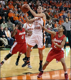 Bowling Green's Chrissy Steffen goes the basket against Dayton's Olivia Applewhite left,, and Amber Dean at the Stroh Center. Steffen had 16 points to go past 1,000 for her career.