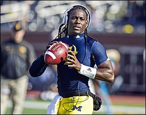Michigan quarterback Denard Robinson has rushed for 4,395 yards.