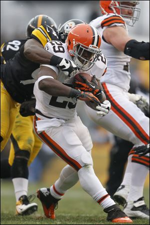 Cleveland Browns running back Brandon Jackson is tackled by Steelers inside linebacker Lawrence Timmons in the first half Sunday in Pittsburgh. The Browns lost 24-10.