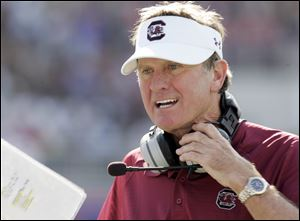 South Carolina's Steve Spurrier has won more than 200 college football games as head coach at Duke, Florida, and with the Gamecocks. He takes his squad into their seventh bowl game in the last eight years on Tuesday against Michigan.