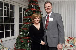 Paul and Karen David, chairmen of the Christ Child Society, during the group's Christmas party at the Toledo Country Club.