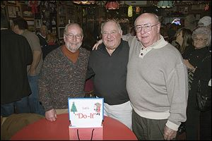 From left, hosts Jeff James, Bob Wasserman, and Ron Buermele at the 46th annual Do-It Party at the Players Club.