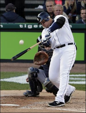 Detroit's Miguel Cabrera hits a two-run home run in the ACLS against the Yankees. Cabrera was selected as the AL MVP and was the first player to win the batting triple crown since 1967.