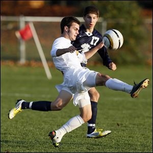 Daniel Blackmar moves the ball against Hayden Neese of St. John's in a Division I boys soccer district semifinal. Blackmar, who had 27 goals this season, helped the Cougars reach the state final.