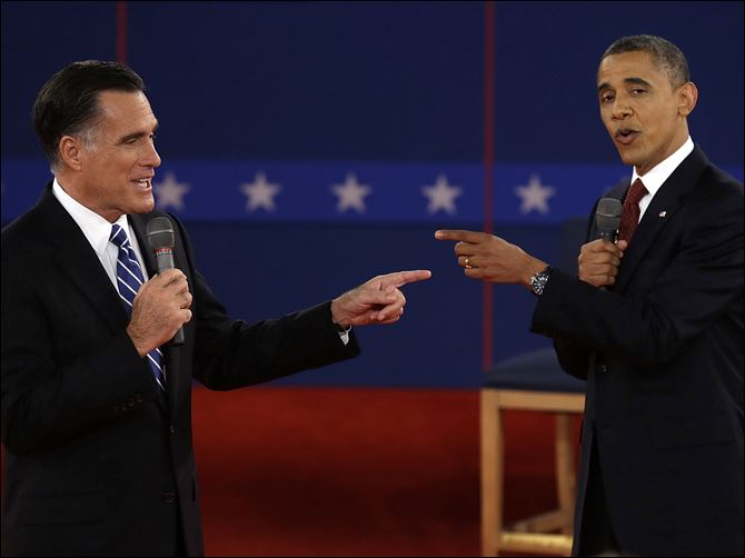 Republican presidential nominee Mitt Romney and President Obama spar during the second presidential debate in Hempstead, N.Y.