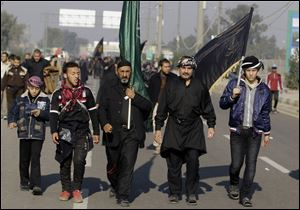 Shiite pilgrims march to Karbala for the Arbaeen celebration in Baghdad, Iraq today. Each year, hundreds of thousands converge on the southern city of Karbala to mark the end of the forty day mourning period following the anniversary of the 7th century death of the Prophet Muhammad's grandson, Imam Hussein.