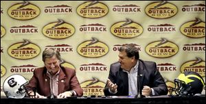 South Carolina head coach Steve Spurrier, left, shares a laugh with Michigan head coach Brady Hoke during a joint news conference Monday in Tampa, Fla.