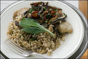 Chinese-styled steamed tilapia is shown served on a plate. As is typical in Chinese cuisine, the secret is in the seasoning.
