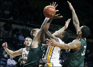 Chicago State's Matt Ross blocks a shot by UT's Rian Pearson, who had 14 points. The Rockets fell to 4-7.